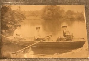 Postcard-Three-Woman-And-A-Child-In-Rowboat-On-A-Lake-boat-Alexandra
