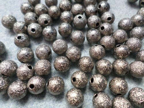 8mm Black Round 20 x Brass Stardust Beads