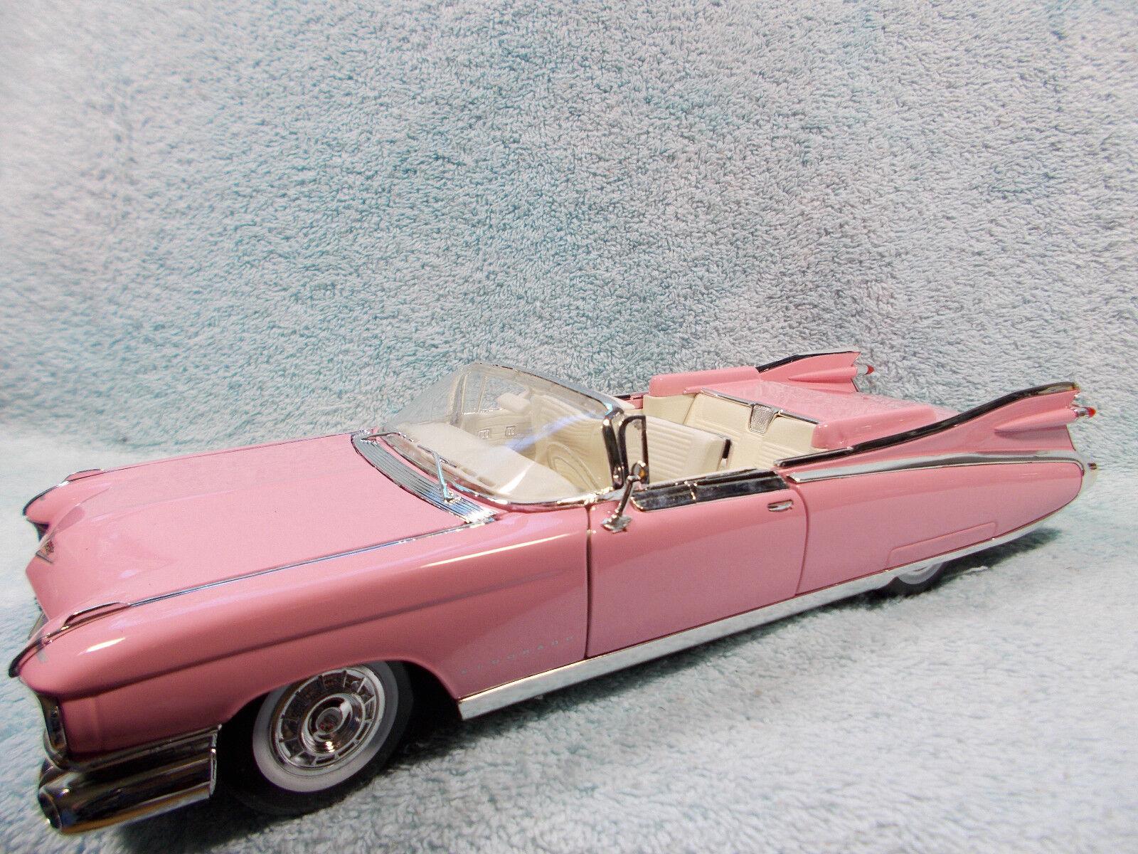 1 18 SCALE DIECAST 1959 CADILLAC ELDORADO BARITZ CABRIOLET IN PINK BY MAISTO.