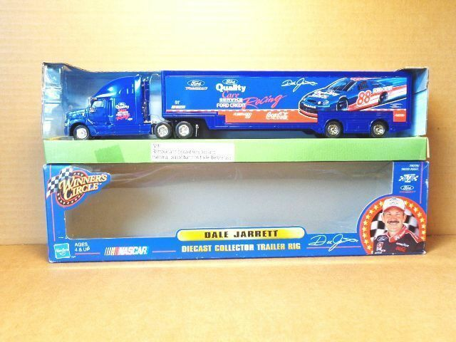 1 64  SCALE FORD TAURUS DIE CAST COLLECTOR TRACTER TRAILER COLOR blueE HASBRO