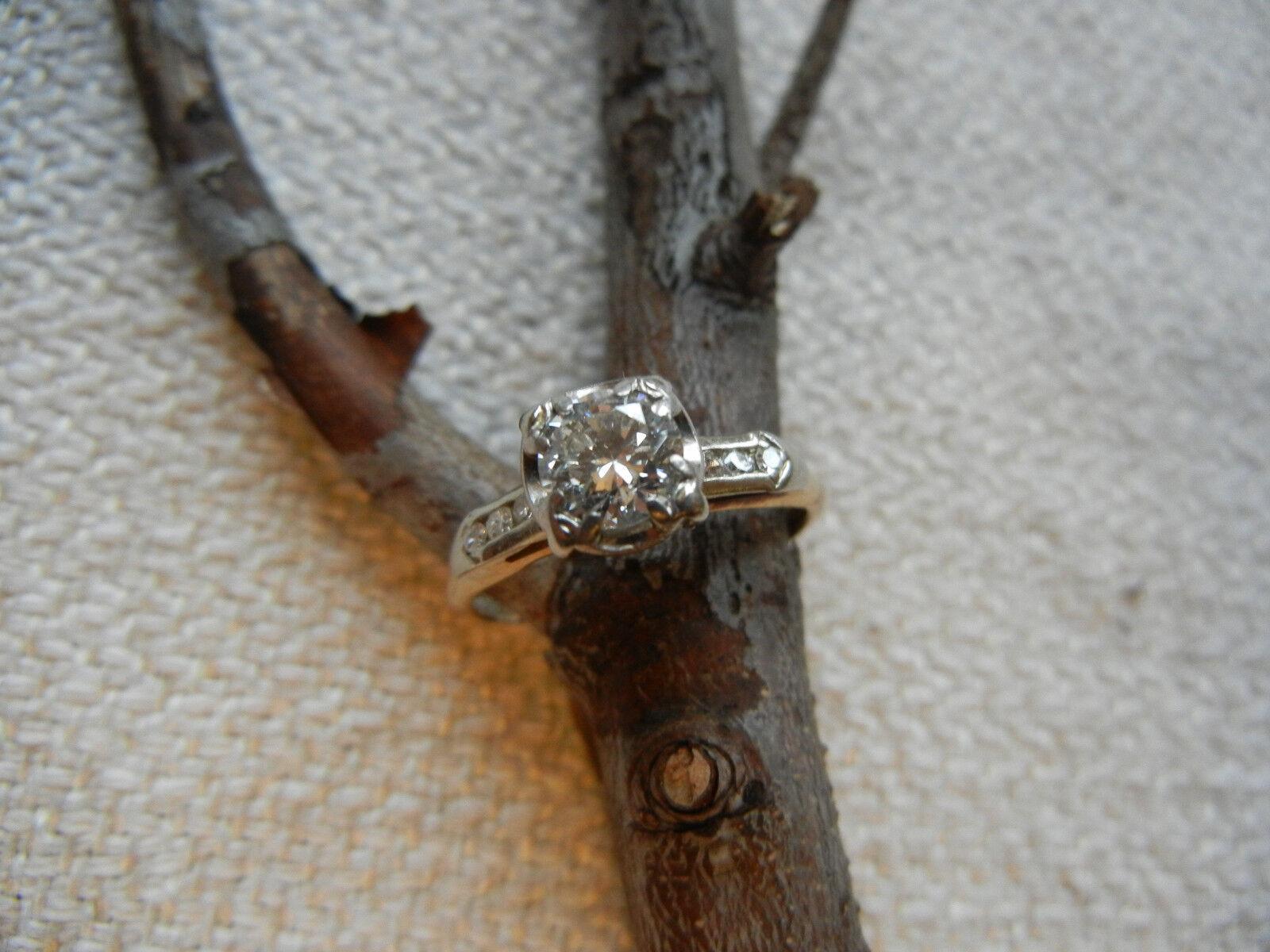 Vintage 14 Karat gold Diamond Ring. Center Stone -.60 Carat. Appraised at  3000