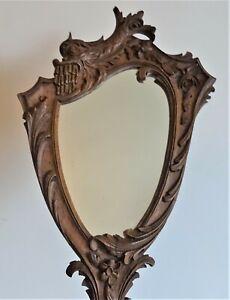 face-a-main-en-bois-sculpte-decor-de-monstre-marin-miroir-art-populaire