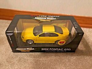 Sealed 1:18 Ertl American Muscle 2004 Yellow Pontiac GTO RC2 Holden