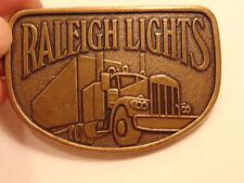 Modern brass colored advertising / trucker belt buckle:  Raleigh Lights
