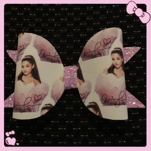 "Ariana Grande. 4/"" Fabric-glitter hair bow on a clip"