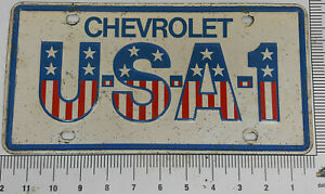 Original-made-of-steel-USA-1-Chevrolet-front-license-plate-tag-not-a-knock-off
