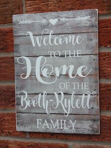 Rustic-Welcome-to-our-home-personalised-wooden-hanging-sign-our-family-plaque