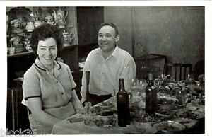 1967-Photo-of-happy-Russian-couple-at-a-festive-table-with-food-and-vine