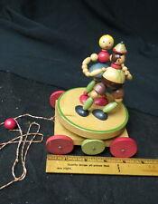 1960 era wooden childs merry go round dance pull toy / holland boy girl / works