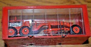 Niveleuse Caterpillar Mini Dinky No. 099 dans son boîtier en plastique d'origine;   Près de la menthe