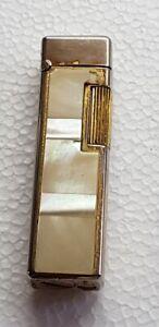 Vecchio-accendino-Colibri-Japan-rifinitura-madreperla-gr-55-vintage