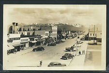 AK Anchorage RPPC 1940's 4TH AVE STREET SCENE Cars STORES Montgomery Ward Store