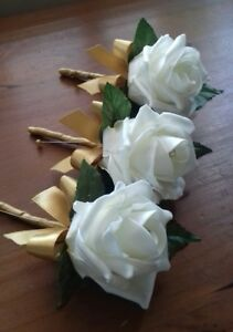 Wedding-rose-ivoru-buttonholes-x-3-diamante-or-pearls-gold-ribbon-bow