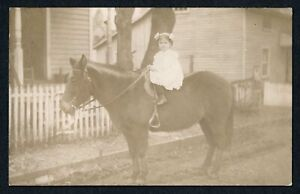 1910-RPPC-Adorable-Little-Girl-Seated-on-Horse