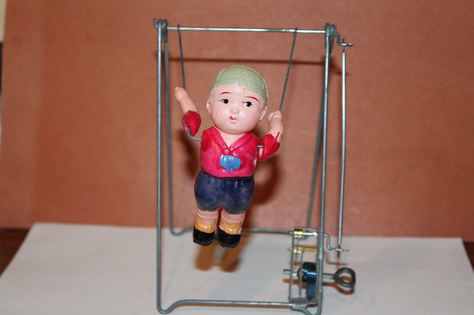 Junge am trapez mechanische wind auf zelluloid