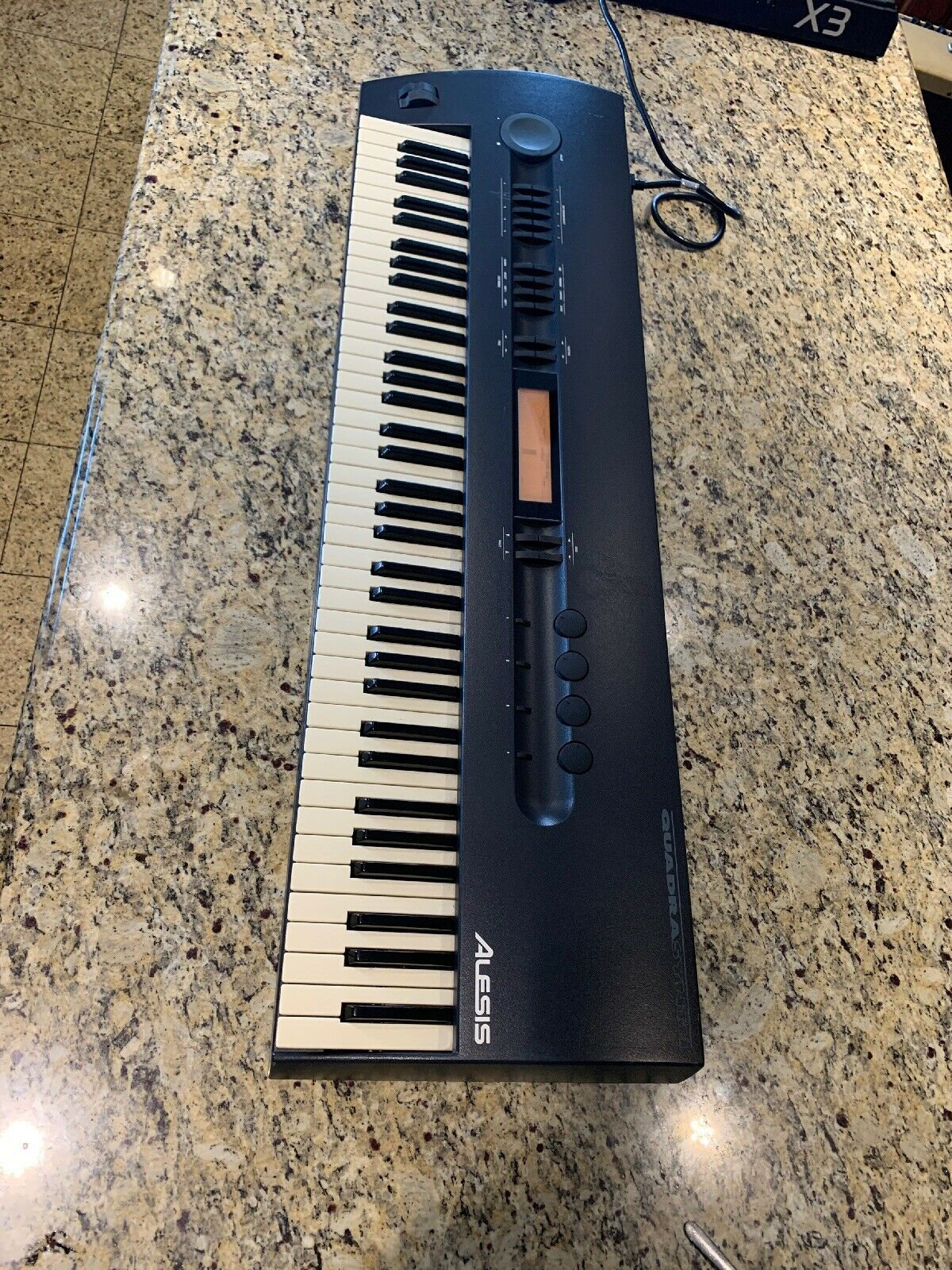 Alesis Quadrasynth 64 Voice 24 Megabyte Expandable Master 76 Key Keyboard