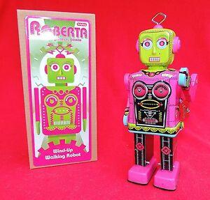 Robot mécanique en tole sérigraphiée.  ROBERTA. Hauteur 20 cm. -  Neuf