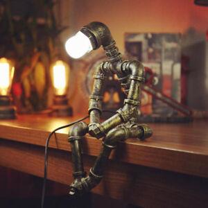 Industrial Loft Bronze Metal Water Pipe Sitting Robot Creative Beside Table Lamp