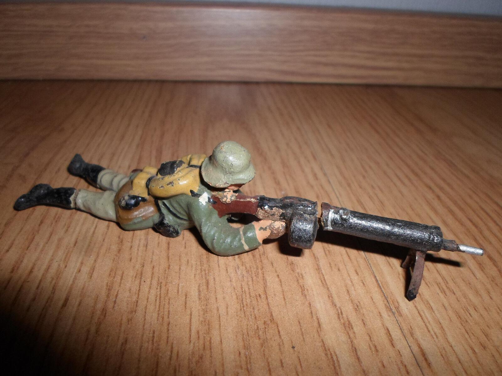 För krig ELASTOLIN LINEOL Tysk soldat med maskingevär, trumtidning WWII