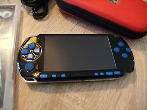 psp 3004 noir et bleue tres propre +jeux
