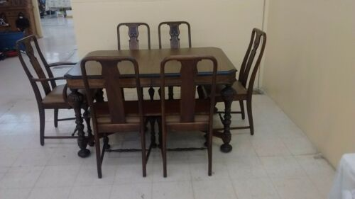 antique Dinning room table with 6 chairs one is a captains chair excellent condi