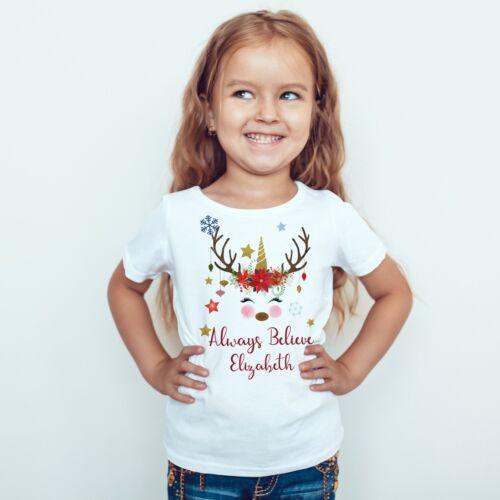 PERSONALISED CHRISTMAS T SHIRT FOR CHILDREN PRESENT UNICORN REINDEER BELIEVE