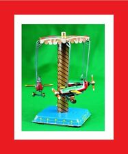 Tin TOY  wind up Jet Airplane Carnival ride remake merry go round carrousel new