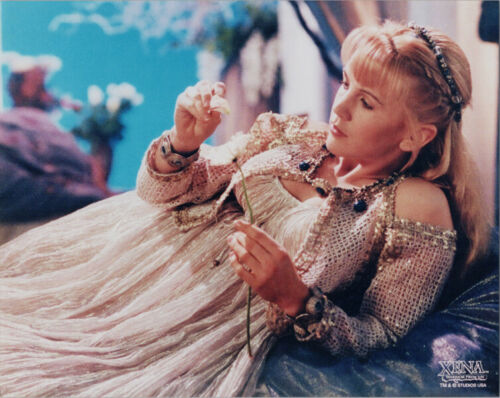 Renee O/'Connor busty pose lying back holding flower Xena TV series 8x10 photo