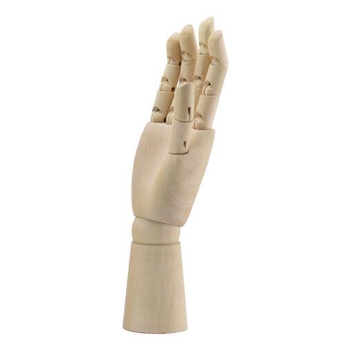 Hölzerne Mannequin Hand scherzt rechte menschliche Hand des menschlichen