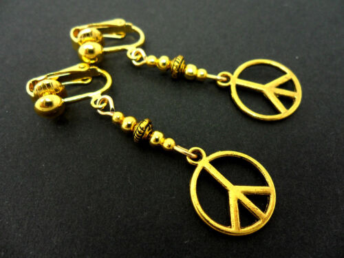 NEW. A PAIR OF  GOLD TONE DANGLY   PEACE SIGN CLIP ON EARRINGS