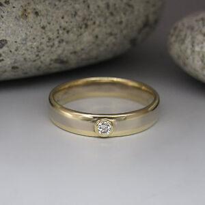 Ring-mit-0-05ct-W-si-Brillant-in-585-14K-Weiss-Gelbgold-Unisex