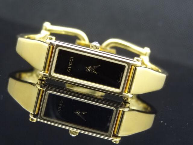 Gucci YA015512 Bangle Gold Tone Band Black Dial 1500 Series Women's Watch