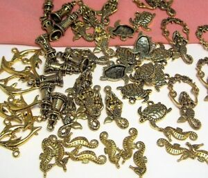 HUGE LOT 55 ASSORTED GOLD CHARMS-MERMAID<wbr/>S-LIGHTHOUSE-T<wbr/>URTLE-DOLPHINS<wbr/>-OCEAN-SEA