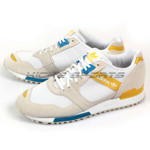 72932a6fd Adidas Originals ZX 700 Contmp W White Blue Yellow Retro Trainers ...