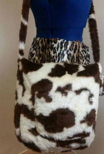 Faux Fur crossbody bag This is a Brown cow print fur shoulder bag