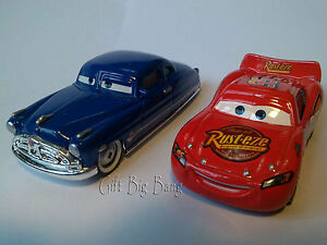 Mattel Disney Pixar Cars Lightning McQueen & Doc Hudson Metal Toys on golf girls, golf handicap, golf accessories, golf tools, golf cartoons, golf trolley, golf machine, golf words, golf players, golf hitting nets, golf buggy, golf games, golf card,