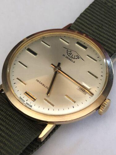 1960 s Talis Ultra Thin watch Horizontal batons en or laminé