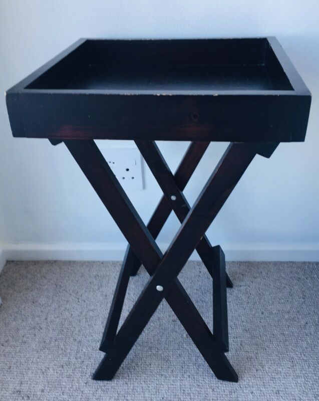 Butlers side tables in wood foldable with removable tray.