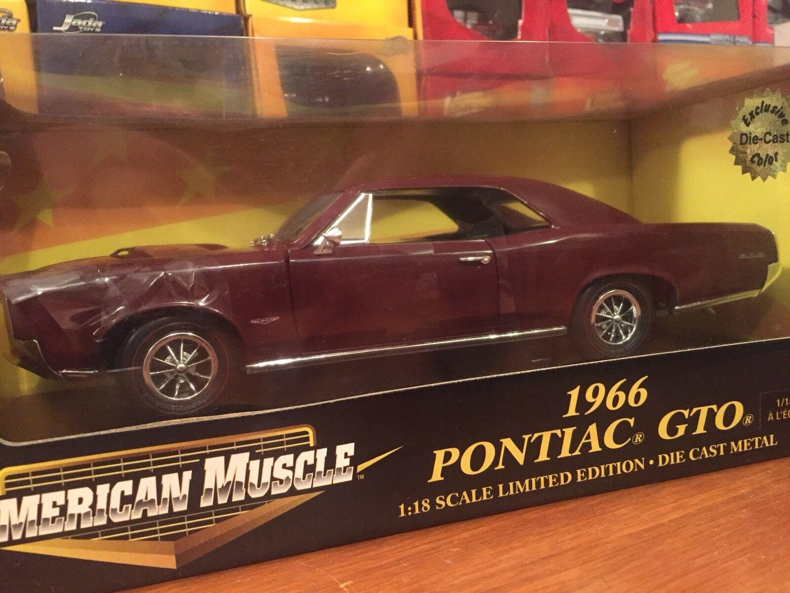 Ertl 1 18 1966 Pontiac GTO ToysRus Exclusive color. Item 32814