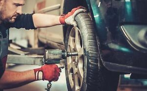 Mechanic at work on a car tire