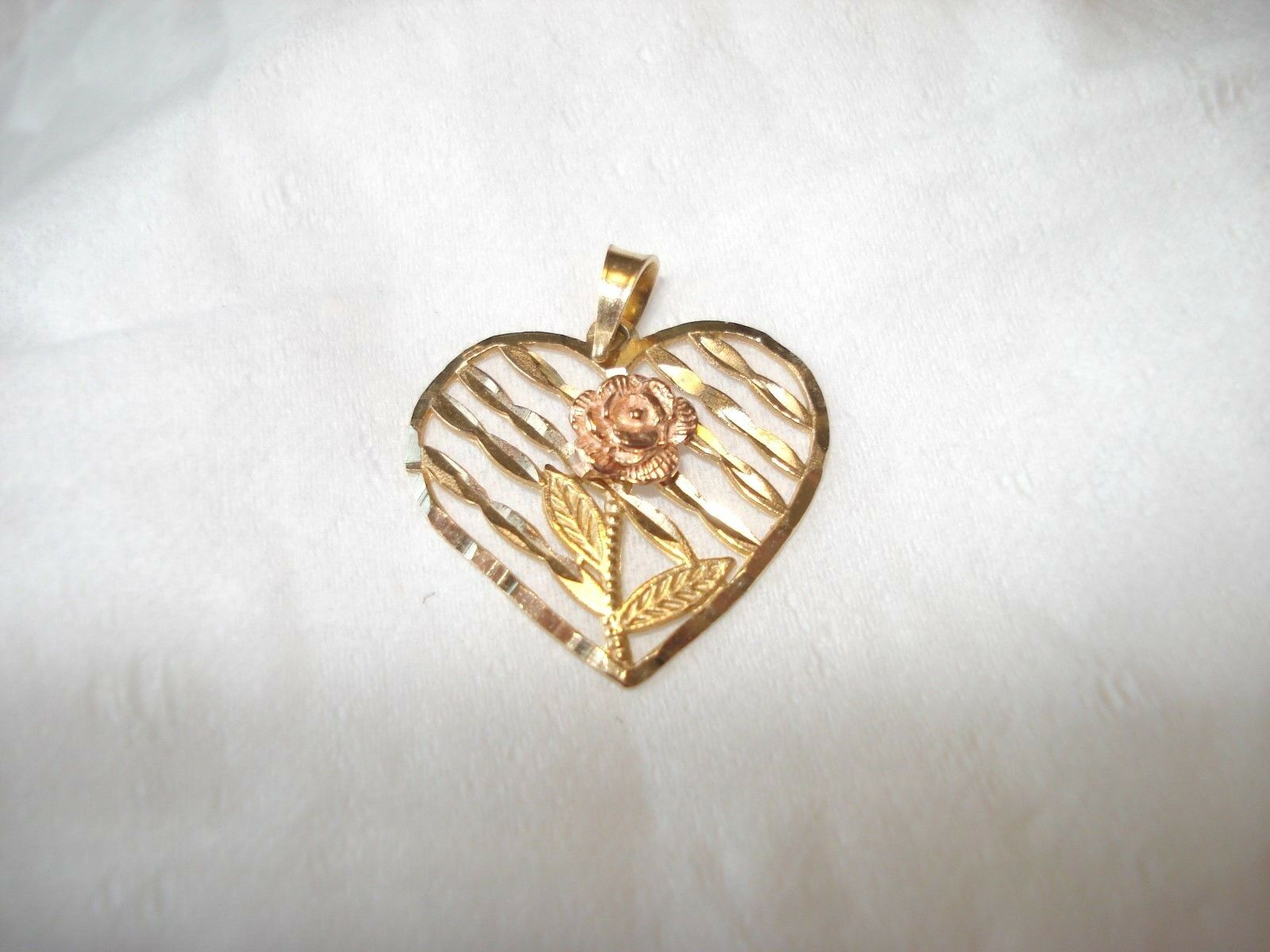 Ladies 10K (41.7%) Solid Yellow gold Heart with pink - .7 Gram