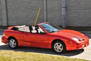 2000 red  Sunfire convertible ,nice car ,