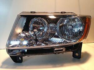2011 2013 jeep grand cherokee headlight oem lh driver. Black Bedroom Furniture Sets. Home Design Ideas