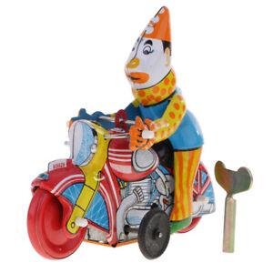 Pagliaccio-su-un-vento-up-motocicletta-Retro-orologeria-giocattolo-di-latta