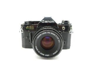 Canon-AE-1-Program-SLR-Spiegelreflexkamera-Canon-Lens-FD-1-8-50mm-Objektiv