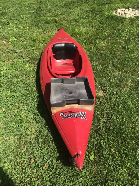 Red Kayak With 2 Paddles And 1 Camo Life Preserver