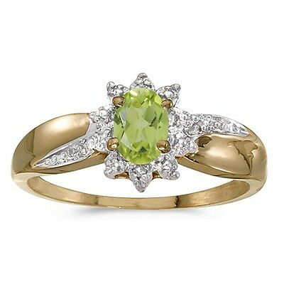 20161012. Certified 10k Yellow Gold Oval Peridot And Diamond Ring 0.41 CTW... Lot 20161012