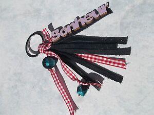 porte clefs bonheur bijou de sac pompon cuir noir 12 cm. Black Bedroom Furniture Sets. Home Design Ideas