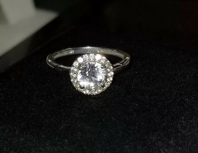 325 Kay Jewelers Kays 10k White gold  white topaz or lab sapphire Halo ring