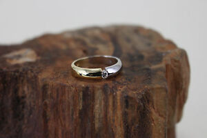 Ring-750er-Weiss-Gelbgold-mit-einem-Diamanten-c06165